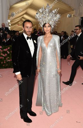 "Tom Ford, Gemma Chan. Tom Ford, left, and Gemma Chan attend The Metropolitan Museum of Art's Costume Institute benefit gala celebrating the opening of the ""Camp: Notes on Fashion"" exhibition, in New York"