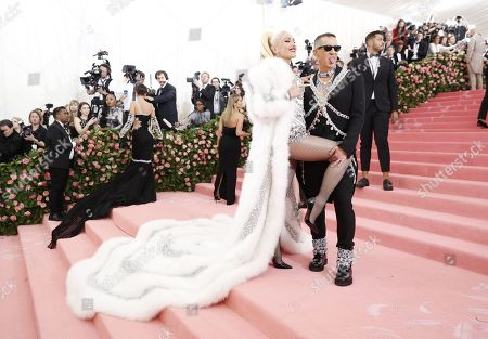 Gwen Stefani (L) and Jeremy Scott arrives on the red carpet for the 2019 Met Gala, the annual benefit for the Metropolitan Museum of Art's Costume Institute, in New York, New York, USA, 06 May 2019. The event coincides with the Met Costume Institute's new spring 2019 exhibition, 'Camp: Notes on Fashion', which runs from 09 May until 08 September 2019.