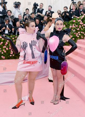 "Lena Dunham, Jemima Kirke. Lena Dunham, left, and Jemima Kirke attend The Metropolitan Museum of Art's Costume Institute benefit gala celebrating the opening of the ""Camp: Notes on Fashion"" exhibition, in New York"