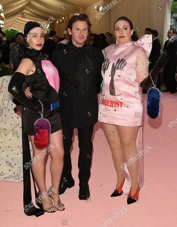 "Lena Dunham, Christopher Kane, Jemima Kirke. Lena Dunham, from left, designer Christopher Kane, and Jemima Kirke attend The Metropolitan Museum of Art's Costume Institute benefit gala celebrating the opening of the ""Camp: Notes on Fashion"" exhibition, in New York"