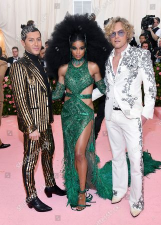 "Evangelo Bousis, Ciara, Peter Dundas. Evangelo Bousis, from left, Ciara and Peter Dundas attend The Metropolitan Museum of Art's Costume Institute benefit gala celebrating the opening of the ""Camp: Notes on Fashion"" exhibition, in New York"