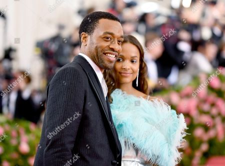 """Chiwetel Ejiofor, Frances Aaternir. Chiwetel Ejiofor, left, and Frances Aaternir attend The Metropolitan Museum of Art's Costume Institute benefit gala celebrating the opening of the """"Camp: Notes on Fashion"""" exhibition, in New York"""
