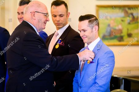 Australian Governor-General Sir Peter Cosgrove presents an Order of Australia medal to Human Nature band member Michael Tierney (R) during an Investiture ceremony at Government House in Canberra, Australian Capital Territory, Australia, 07 May 2019. The Governor-General invested members of the band with Order of Australia Medals (OAM).