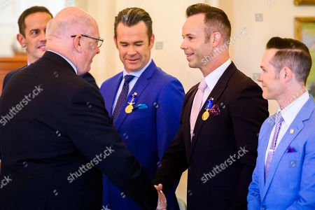 Stock Image of Australian Governor-General Sir Peter Cosgrove presents Order of Australia medals to Human Nature band members Toby Allen, Phil Burton, Andrew Tierney and Michael Tierney during an Investiture ceremony at Government House in Canberra, Australian Capital Territory, Australia, 07 May 2019. The Governor-General invested members of the band with Order of Australia Medals (OAM).