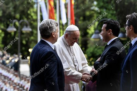 Pope Francis (C) is welcomed by North Macedonia's Prime Minister Zoran Zaev (2-L) and President Gjorge Ivanov (L) during a welcome ceremony at the Presidential Palace in Skopje, North Macedonia, 07 May 2019. Pope Francis is visiting Bulgaria and North Macedonia from 05 to 07 May; his 29th Apostolic Journey abroad.