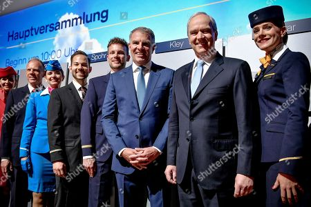 Chairman of the board Karl-Ludwig Kley (2-R) and Chief Executive Officer (CEO) Carsten Spohr (3-R) of German airline Lufthansa pose prior to the annual shareholders' meeting of Lufthansa Group at the World Conference Center (WCC) in Bonn, Germany, 07 May 2019.