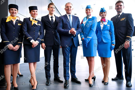 Chief Executive Officer (CEO) Carsten Spohr (C) and flight attendants of German airline Lufthansa pose prior to the annual shareholders' meeting of Lufthansa Group at the World Conference Center (WCC) in Bonn, Germany, 07 May 2019.