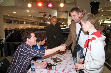Stock Photo of Director Marc Price and actor Alistair Kurton meet fans