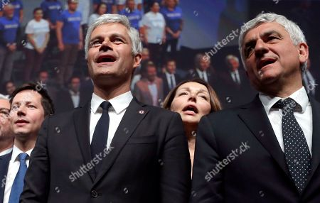 Laurent Wauquiez, left, President of the Republican Party, and Herve Morin, right, President of France Regions, and parliament member Valerie Boyer, center behind, sing the national anthem during a campaign meeting in Marseille, southern France, . The European elections will take place from 23 to May 26