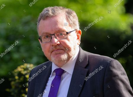 David Mundell, Secretary of State for Scotland, arrives in Downing Street for the Cabinet meeting.