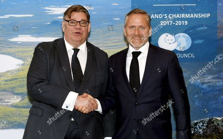 Foreign Minister of Finland Timo Soini (L) and his Danish counterpart Anders Samuelsen shaking hands during the Arctic Council Ministerial Meeting in Rovaniemi, Finnish Lapland