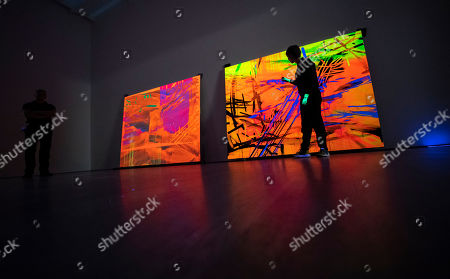 Curator Patrizia Dander poses next to the Artwork 'Black Light Painting' by the American Artist Jacqueline Humphries during the installation of the exhibition 'Forever Young - 10 Years of Museum Brandhorst' at the Museum Brandhorst in Munich, Germany, 07 May 2019. The exhibition comprises around 250 works by 45 artists, including Andy Warhol, Cy Twombly, Bruce Nauman, Cady Noland, and Wolfgang Tillmans, and will open on 23 May.
