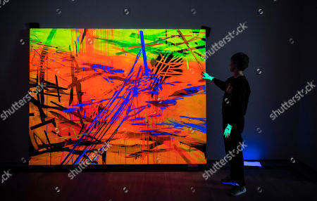 Curator Patrizia Dander poses next to the Artwork 'Black Light Painting' by the American Artist Jacqueline Humphries during the installation of the exhibition 'Forever Young - 10 Years of Museum Brandhorst'at the Museum Brandhorst in Munich, Germany, 07 May 2019. The exhibition comprises around 250 works by 45 artists, including Andy Warhol, Cy Twombly, Bruce Nauman, Cady Noland, and Wolfgang Tillmans, and will open on 23 May.