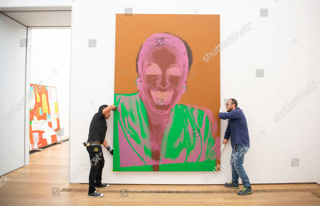 The artwork 'Ladies and Gentleman' (1975) by the American Artist Andy Warhol is carried by two employees preparing the exhibition 'Forever Young - 10 Years of Museum Brandhorst' at the Museum Brandhorst in Munich, Germany, 07 May 2019. The exhibition comprises around 250 works by 45 artists, including Andy Warhol, Cy Twombly, Bruce Nauman, Cady Noland, and Wolfgang Tillmans, and will open on 23 May.