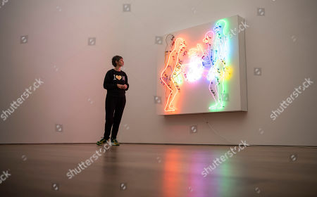 Curator Patrizia Dander posese next to the Artwork 'Mean Clown Welcome' by the American Artist Bruce Nauman during the installation of the exhibition 'Forever Young - 10 Years of Museum Brandhorst' at the Museum Brandhorst in Munich, Germany, 07 May 2019. The exhibition comprises around 250 works by 45 artists, including Andy Warhol, Cy Twombly, Bruce Nauman, Cady Noland, and Wolfgang Tillmans, and will open on 23 May.