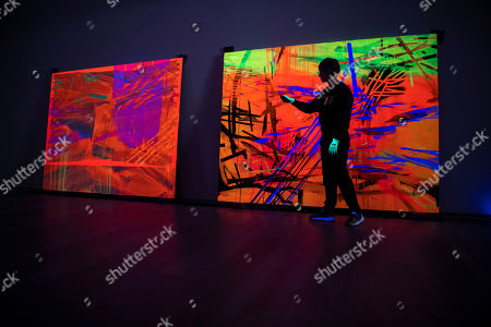 Stock Photo of Curator Patrizia Dander poses next to the Artwork 'Black Light Painting' by the American Artist Jacqueline Humphries during the installation of the exhibition 'Forever Young - 10 Years of Museum Brandhorst' at the Museum Brandhorst in Munich, Germany, 07 May 2019. The exhibition comprises around 250 works by 45 artists, including Andy Warhol, Cy Twombly, Bruce Nauman, Cady Noland, and Wolfgang Tillmans, and will open on 23 May.