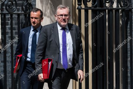 Secretary of State for Wales Alun Cairns (L) and Secretary of State for Scotland David Mundell (R) leave 10 Downing Street after the weekly Cabinet meeting.