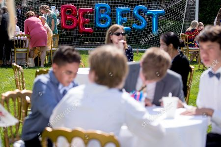 Stock Image of Invited guests write cards in the Jacqueline Kennedy Garden as part of a one year anniversary event for the first lady's Be Best initiative in the Rose Garden of the White House, in Washington
