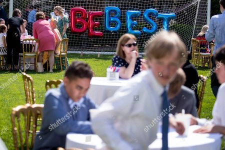 Invited guests write cards in the Jacqueline Kennedy Garden as part of a one year anniversary event for the first lady's Be Best initiative in the Rose Garden of the White House, in Washington