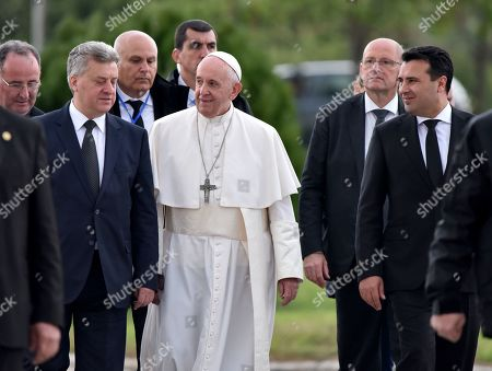 Pope Francis (C) accompanied with North Macedonia's President Gjorge Ivanov (L) and Prime Minister Zoran Zaev (R) as he boards an airplane at the Skopje airport, North Macedonia, 07 May 2019. On his three-days apostolic journey, Pope Francis traveled to Bulgaria and Republic of North Macedonia.