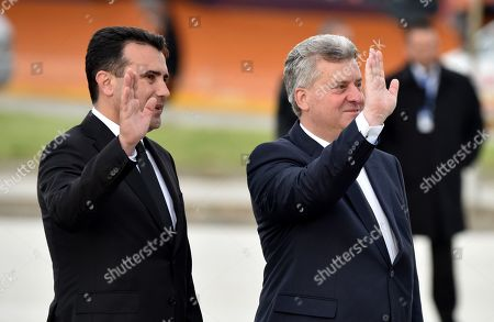 North Macedonia's President Gjorge Ivanov (R) and Prime Minister Zoran Zaev (L) wave as Pope Francis (not pictured) boards an airplane at the Skopje airport, North Macedonia, 07 May 2019. On his three-days apostolic journey, Pope Francis traveled to Bulgaria and Republic of North Macedonia.