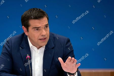 Alexis Tsipras, Euklid Tsakalotos. Greek Prime Minister Alexis Tsipras announces bailout relief measures during a press conference in Athens, on . Greece's left-wing prime minister has promised crisis-weary voters a series of tax-relief measures ahead of elections, after outperforming budget targets set by bailout creditors