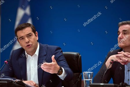 Stock Image of Alexis Tsipras, Euklid Tsakalotos. Greek Prime Minister Alexis Tsipras, left, announces bailout relief measures, next to Greek Financial Minister Euklid Tsakalotos, during a press conference, in Athens, on . Greece's left-wing prime minister has promised crisis-weary voters a series of tax-relief measures ahead of elections, after outperforming budget targets set by bailout creditors