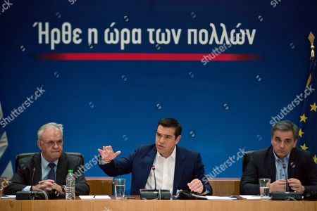 Alexis Tsipras, Euklid Tsakalotos, Yannis Dragasakis. Greek Prime Minister Alexis Tsipras, center, announces bailout relief measures next to the Greek Financial Minister Euklid Tsakalotos, right, and the Deputy Prime Minister Yannis Dragasakis, during a press conference, in Athens, on . Greece's left-wing prime minister has promised crisis-weary voters a series of tax-relief measures ahead of elections, after outperforming budget targets set by bailout creditors