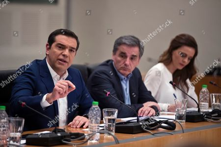 Alexis Tsipras, Euklid Tsakalotos, Effie Achtsioglou. Greek Prime Minister Alexis Tsipras, left, announces bailout relief measures next to Greek Financial Minister Euklid Tsakalotos center, and Greek Labour Minister Effie Achtsioglou, right, during a press conference, in Athens, on . Greece's left-wing prime minister has promised crisis-weary voters a series of tax-relief measures ahead of elections, after outperforming budget targets set by bailout creditors