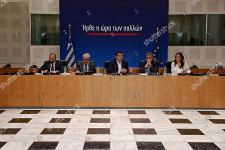 Greek Prime Minister Alexis Tsipras (C) with Finance Minister Euclid Tsakalotos (2R), Labour Minister Effie Achtsioglou (R), Deputy Prime Minister Yiannis Dragasakis (2L) and government spokesman Dimitris Tzanakopoulos (L) adress to the journalists during a press conference to announce the package of positive measures, in Athens, Greece, 07 May 2019. The relevant draft law will be tabled in parliament over the next days and will include among others the framework for the 120-installment debt settlement to social security funds and the Tax Bureau.