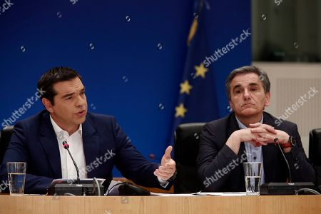 Greek Prime Minister Alexis Tsipras (L) with Finance Minister Euclid Tsakalotos (R) adress to the journalists during a press conference to announce the package of positive measures, in Athens, Greece, 07 May 2019. The relevant draft law will be tabled in parliament over the next days and will include among others the framework for the 120-installment debt settlement to social security funds and the Tax Bureau.