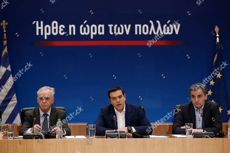 Greek Prime Minister Alexis Tsipras (C) with Finance Minister Euclid Tsakalotos (R), Deputy Prime Minister Yiannis Dragasakis (L) adress to the journalists during a press conference to announce the package of positive measures, in Athens, Greece, 07 May 2019. The relevant draft law will be tabled in parliament over the next days and will include among others the framework for the 120-installment debt settlement to social security funds and the Tax Bureau.