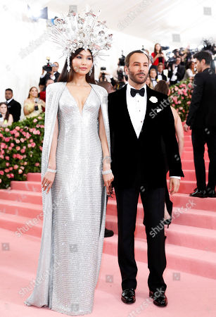Actress Gemma Chan (L) and designer Tom Ford pose on the red carpet for the 2019 Met Gala, the annual benefit for the Metropolitian Museum of Art's Costume Institute, in New York, New York, USA, 06 May 2019. The event coincides with the Met Costume Institute's new spring 2019 exhibition, 'Camp: Notes on Fashion', which runs from 09 May until 08 September 2019.