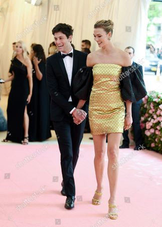 """Stock Image of Joshua Kushner, Karlie Kloss. Joshua Kushner, left, and wife Karlie Kloss arrive at The Metropolitan Museum of Art's Costume Institute benefit gala celebrating the opening of the """"Camp: Notes on Fashion"""" exhibition, in New York"""