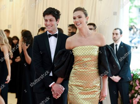 """Joshua Kushner, Karlie Kloss. Joshua Kushner, left, and wife Karlie Kloss arrive at The Metropolitan Museum of Art's Costume Institute benefit gala celebrating the opening of the """"Camp: Notes on Fashion"""" exhibition, in New York"""