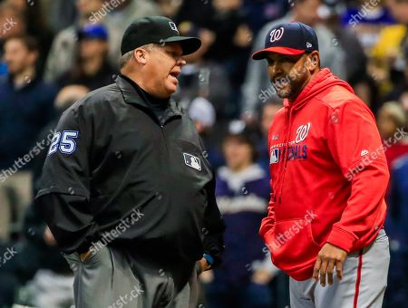 Washington Nationals manager Dave Martinez (R) talks with umpire crew chief Feldin Culbreth (L) after home plate umpire ejected Washington Nationals third baseman Anthony Rendon for arguing a third strike call in the seventh inning of the MLB baseball game between the Washington Nationals and the Milwaukee Brewers at Miller Park in Milwaukee, Wisconsin, USA, 07 May 2019.
