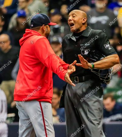Washington Nationals manager Dave Martinez (L)argues with home plate umpire CB Bucknor (R) after Bucknor ejected Washington Nationals third baseman Anthony Rendon for arguing a third strike call in the seventh inning of the MLB baseball game between the Washington Nationals and the Milwaukee Brewers at Miller Park in Milwaukee, Wisconsin, USA, 07 May 2019.