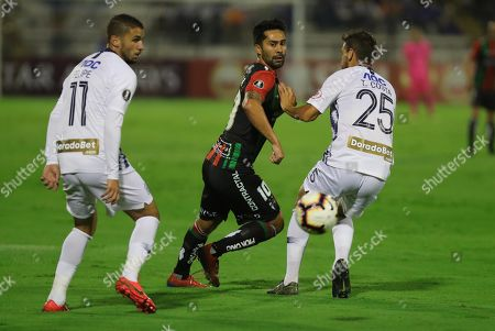 Felipe Rodriguez (L) and Tomas Costa (R) of Alianza Lima in action against Luis Jimenez (C) of Palestino during the Copa Libertadores group A soccer match between Alianza Lima and Palestino at Alejandro Villanueva Stadium in Lima, Peru, 07 May 2019.