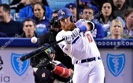 Justin Turner, Tyler Flowers, Andy Fletcher. Los Angeles Dodgers' Justin Turner hits a solo home run as Atlanta Braves catcher Tyler Flowers watches along with home plate umpire Andy Fletcher during the first inning of a baseball game, in Los Angeles