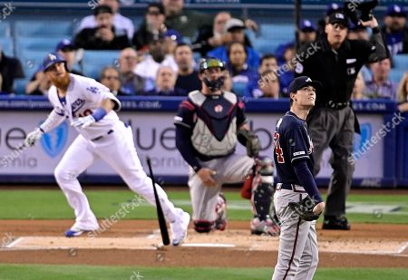 Justin Turner, Kevin Gausman, Tyler Flowers, Andy Fletcher. Los Angeles Dodgers' Justin Turner, left, hits a solo home run as Atlanta Braves starting pitcher Kevin Gausman, foreground, watches along with catcher Tyler Flowers and home plate umpire Andy Fletcher during the first inning of a baseball game, in Los Angeles