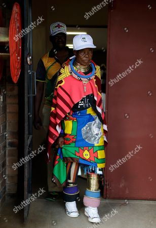Stock Photo of Esther Mahlangu, a contemporary South African artist, leaves the voting station after casting her vote in presidential and parliamentary elections at KwaMhlanga in Mpumalanga, South Africa, . South Africans have started voting in presidential and parliamentary elections amid issues of corruption and unemployment. It is 25 years after the end of apartheid, but despite the demise of the system of racial discrimination the country remains divided by economic inequality