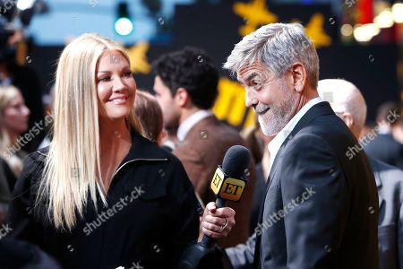 George Clooney (R) is interviewed by Nancy O'Dell as he arrives for the premiere of Hulu's 'Catch 22' at the TCL Chinese Theatre IMAX in Hollywood, Los Angeles, California, USA, 07 May 2019. The movie opens in US theaters on 17 May 2019.