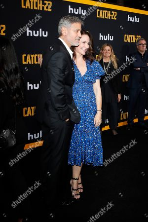 George Clooney (L) poses with actress Kristen Davis as he arrives for the premiere of Hulu's 'Catch 22' at the TCL Chinese Theatre IMAX in Hollywood, Los Angeles, California, USA, 07 May 2019. The movie opens in US theaters on 17 May 2019.