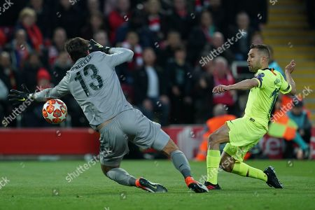 Stock Picture of Liverpool's Alison Becker saves a shot from Barcelona's Jordi Alba