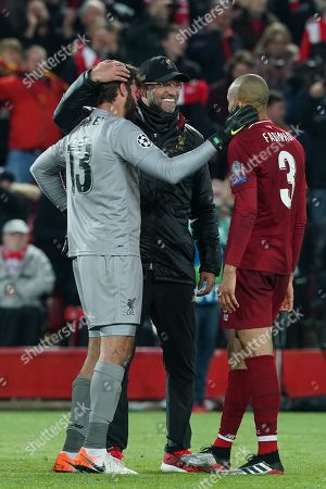 Stock Image of Liverpool manager Jurgen Klopp celebrates with Liverpool's Alison Becker (L) and Liverpool's Fabinho (R)