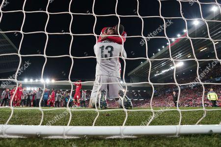 Stock Photo of Liverpool's Georginio Wijnaldum congratulates Liverpool's Alison Becker at the end of the match