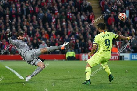 Liverpool's Alison Becker under pressure from Barcelona's Luis Suarez