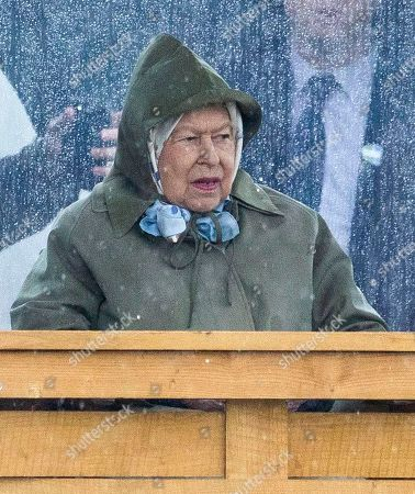 Queen Elizabeth II watches her horses in the 4 Year Old Hunter Class