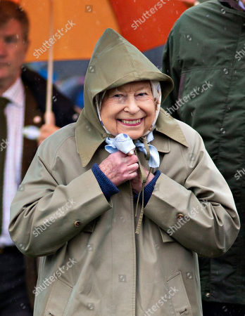 Queen Elizabeth II leaves after watching her horses in the 4 Year Old Hunter Class