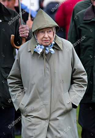 Stock Image of Queen Elizabeth II leaves after watching her horses in the 4 Year Old Hunter Class